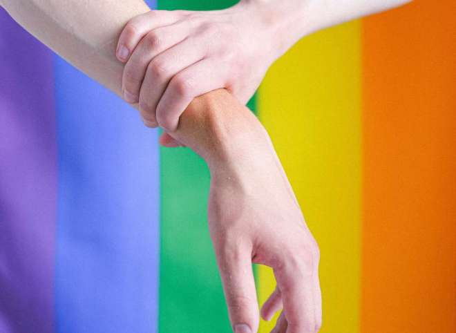 arms-in-front-of-a-gay-pride-flag-4611697